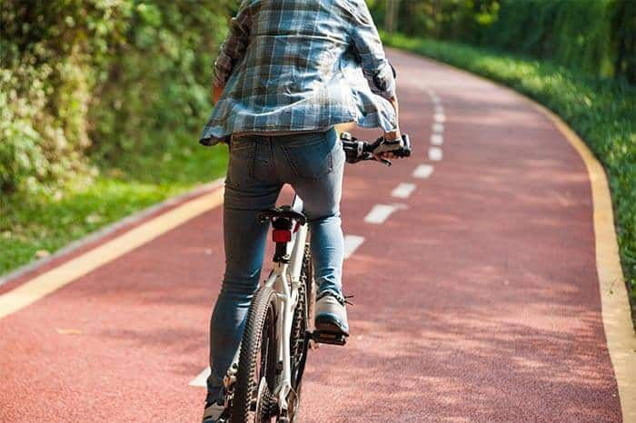 riding a mountain bike on pavement
